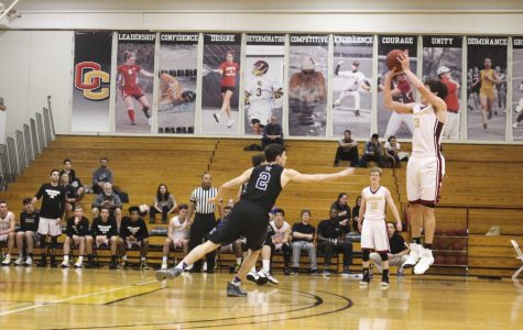 Sophomore Eli Silverman-Lloyd shoots a three-pointer in Oberlin's 80–60 win against Kenyon College.  The Yeomen concluded their season 3–22 overall and 2–16 in the NCAC.