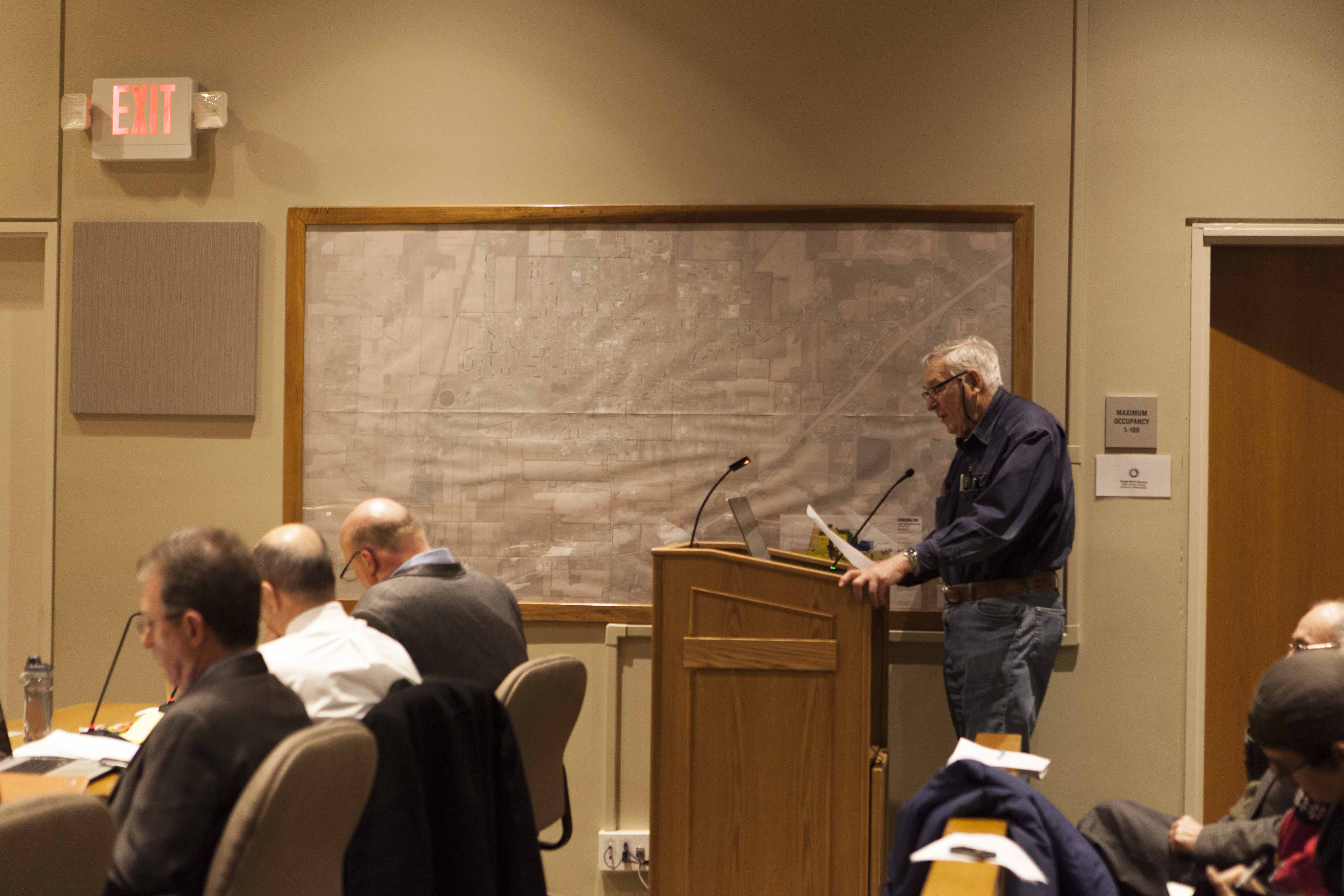 John Elder speaks to City Council at its meeting Monday night concerning the city's Renewable Energy Credits. The council  voted to let citizens return their rebate to the Community Choice Fund.