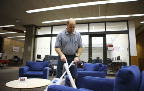 Jeff  Mazze at Mudd library is one of the remaining custodial staff  members after many took the College's staff  buyout program. Twenty-one members of his union, UAW, left their positions at the end of 2016.