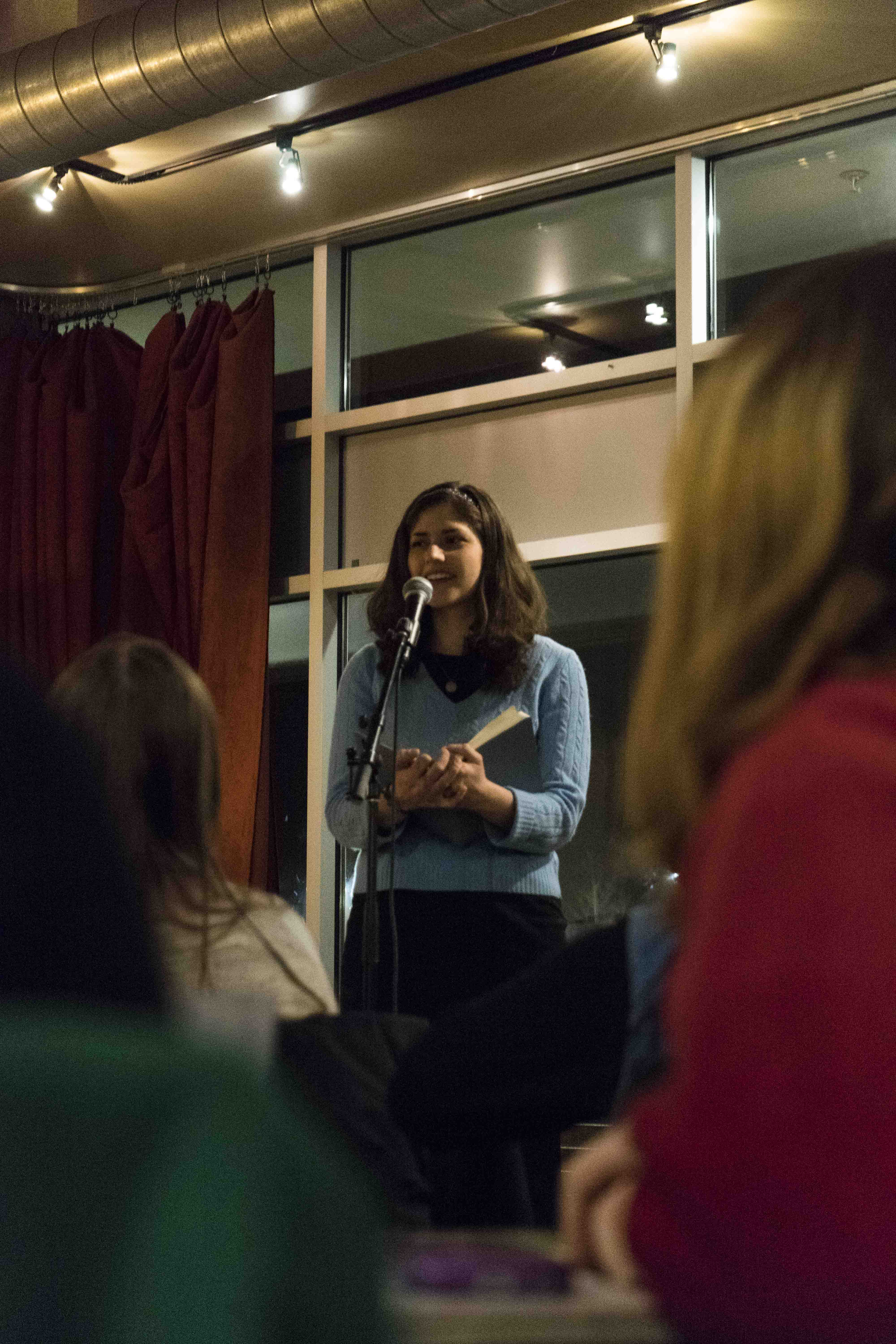 College senior Sarah Chatta performs at Slow Train for Love in Many Tongues, a multilingual poetry reading organized each year by the Oberlin Center for Languages and Cultures to celebrate Valentine's Day.