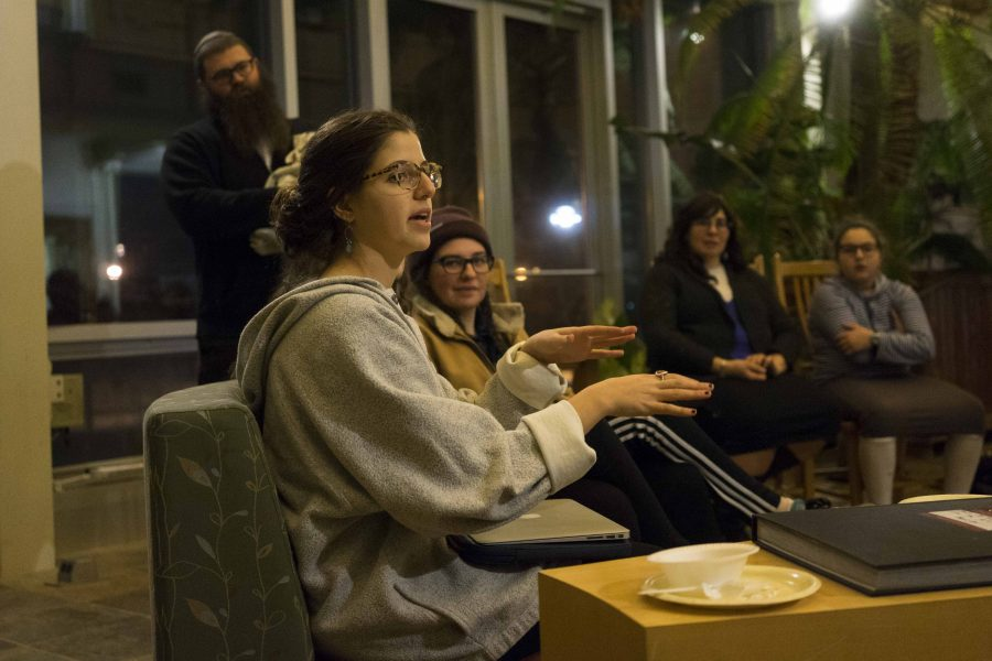 """College senior Isabelle Harari speaks at """"Roots: Exploring Jewish Identity Through Family Stories & Culinary Traditions,"""" an event Wednesday put on as part of the """"How Do You Jew?"""" series."""