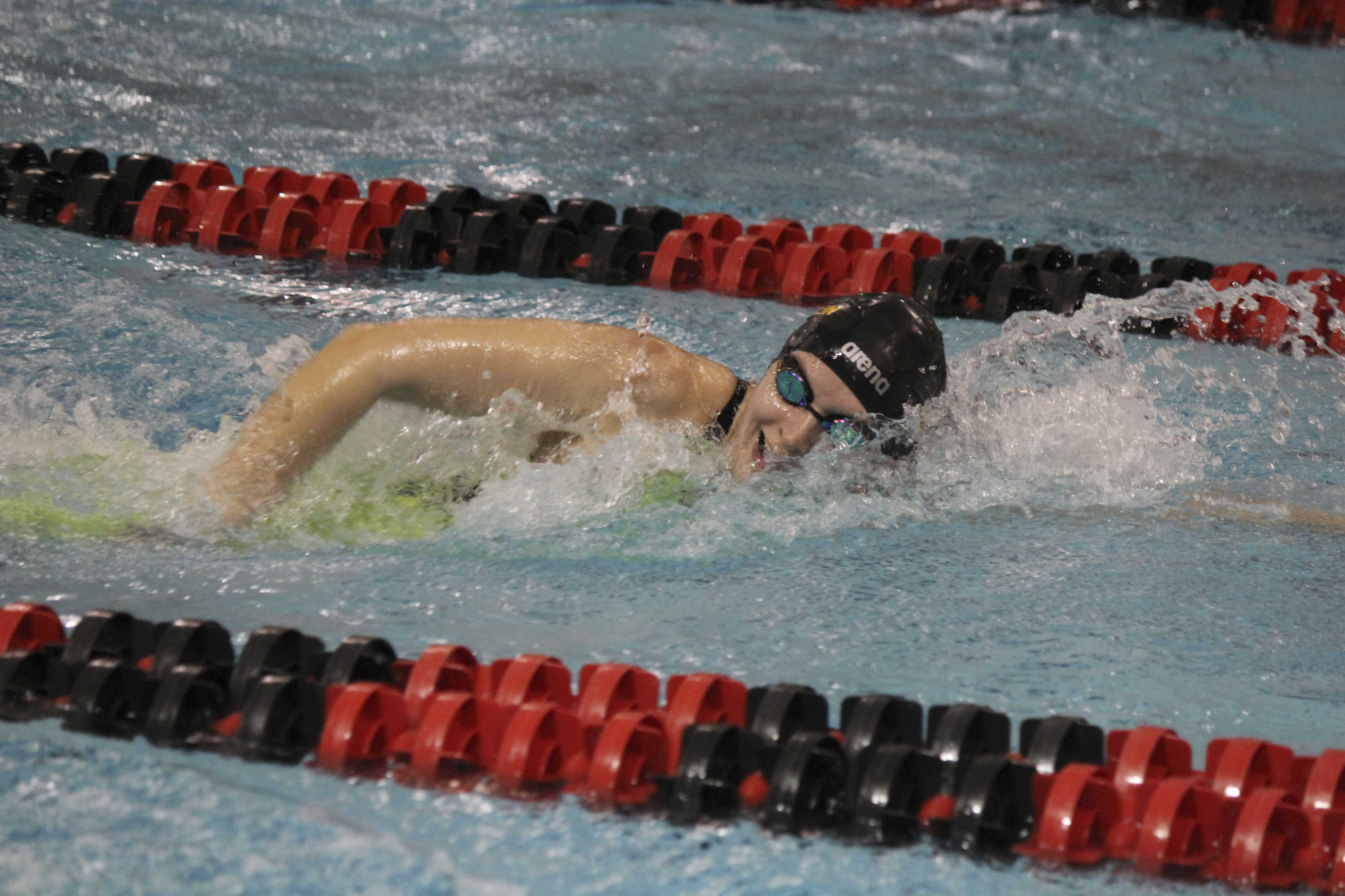 Senior Maddie Prangley swims the freestyle at the NCAC Championships. Prangley broke the 1,650 freestyle program record with a time of 17:32.28 to secure a seventh-place finish.