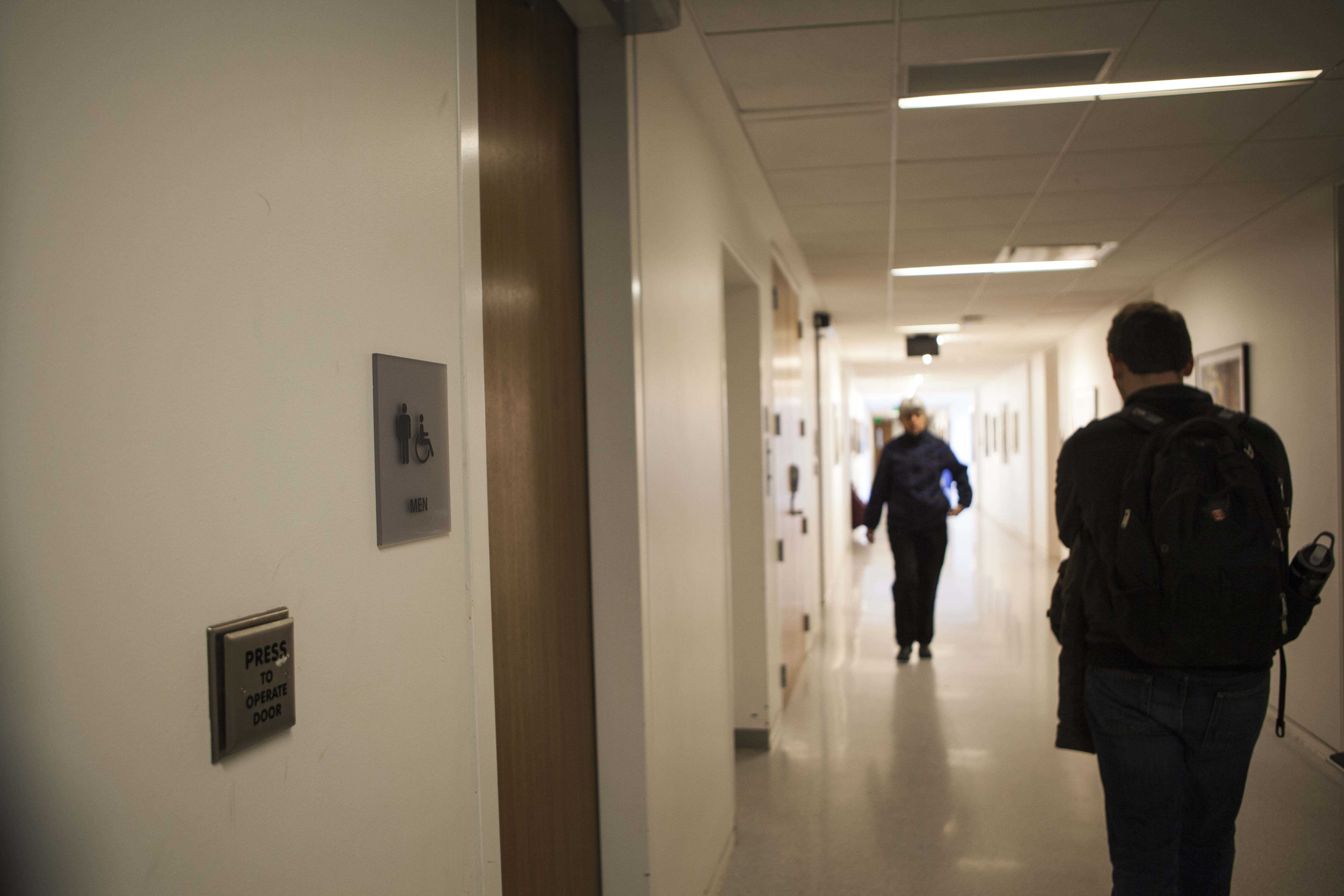Students pass a men's restroom in Bibbins Hall, a Conservatory building that has no gender-neutral bathrooms. Renovations this summer will address this issue as gender-neutral bathrooms will be included on the first- and third-floors of the building.