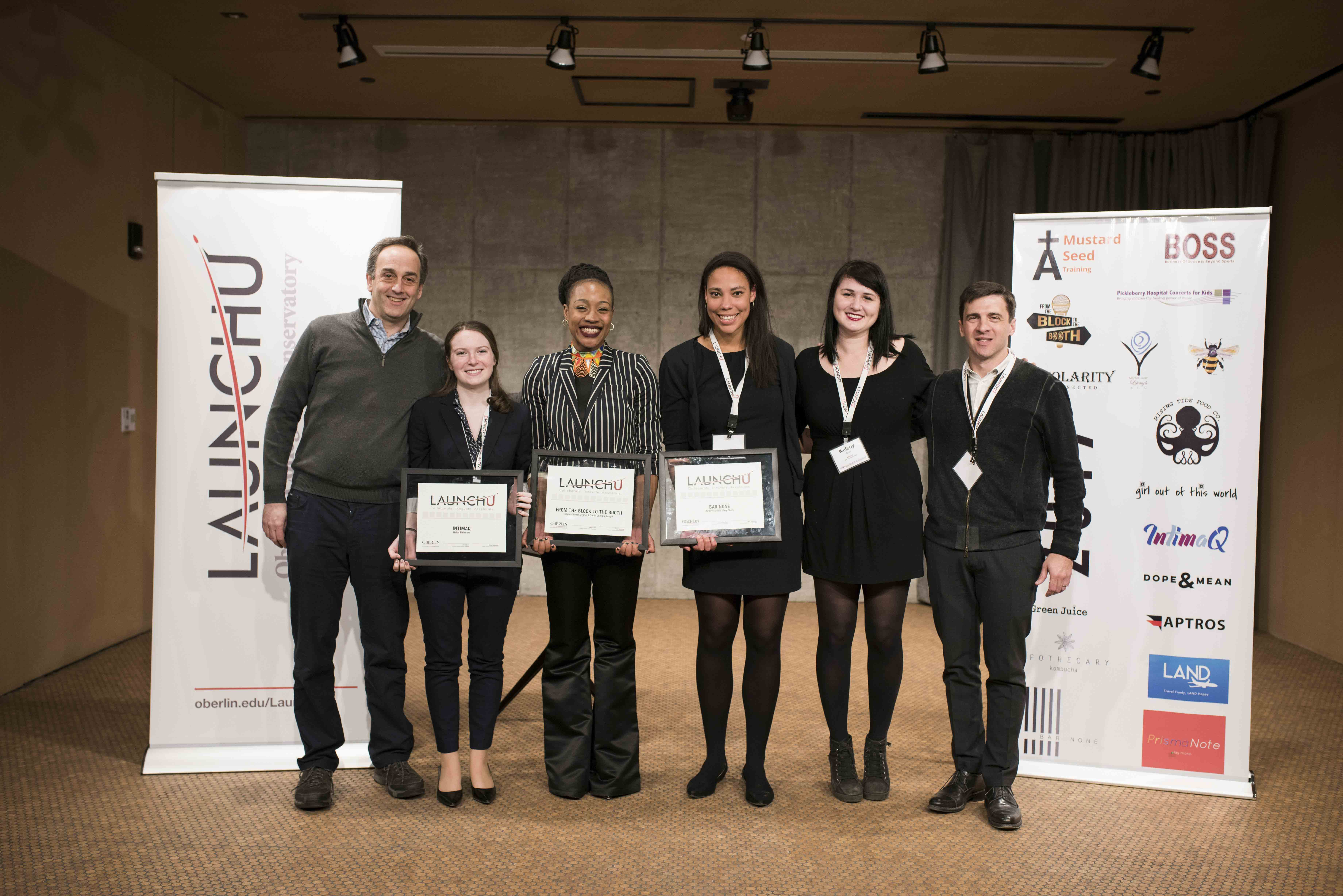 Conservatory junior Helen Fleischer, Sophie Mvurya, OC '16, Mary Okoth, OC '14, and Kelsey Scult, OC '14, receive the 2017 LaunchU awards. Their three startups earned a collective $45,000 after winning the March 4 Launch U competition.
