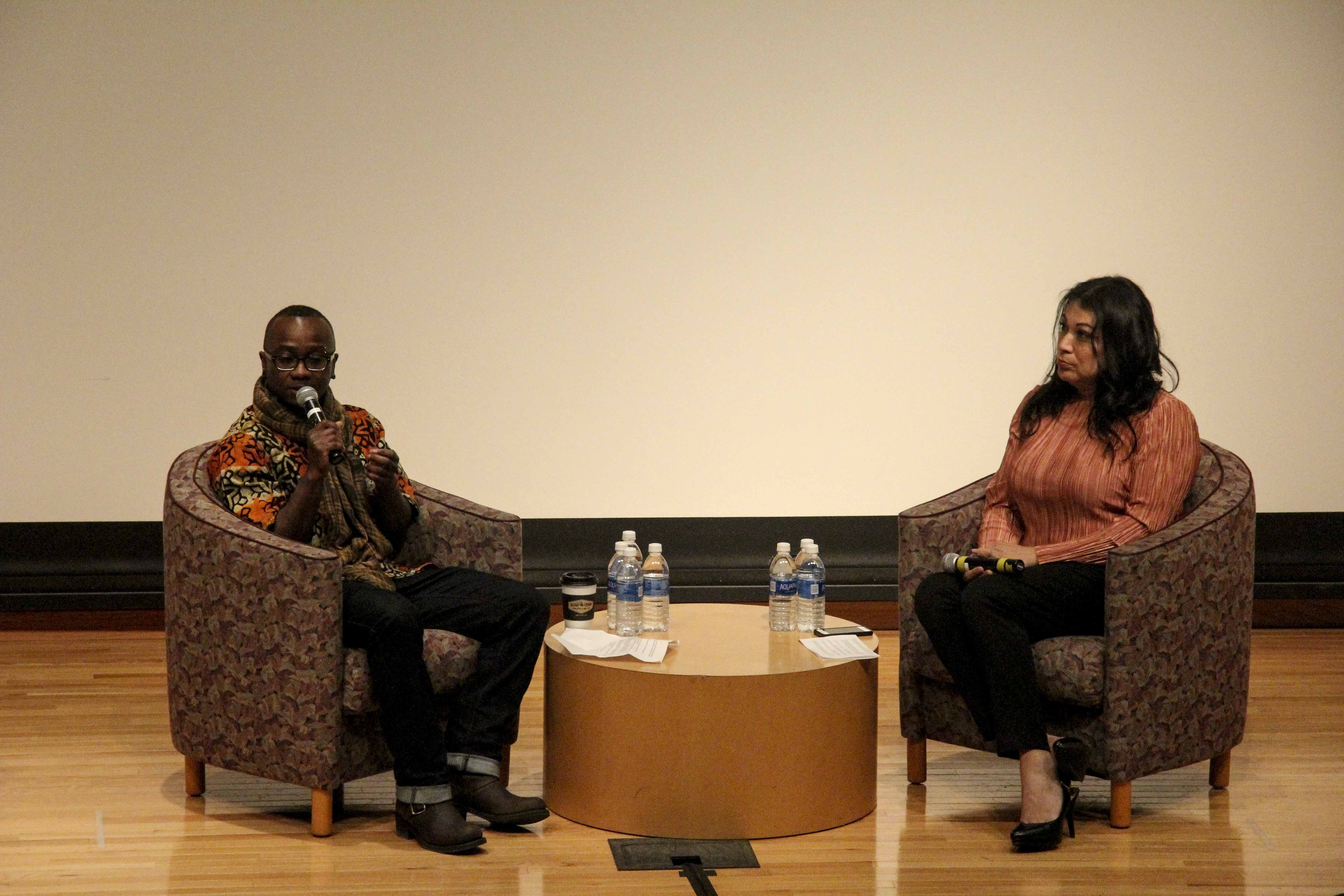 Undocumented trans activists Ola Osaze (left), Nigerian-born, and Jennicet Gutiérrez, who came to the U.S. from Mexico in her teens, interview one another in front of an audience at My Name is My Own, an event hosted by the Multicultural Resource Center in Dye Lecture Hall Thursday night. My Name is My Own's primary mission is to provide institutional support to Oberlin communities that identify as queer and of color in the broadest senses of those words. Discussion topics ranged from political promises by current and past administrations in the face of increasing violence against Black, brown, trans and immigrant bodies to the importance of self love and joy in social and political climates that provide little of either to minority communities across the board.