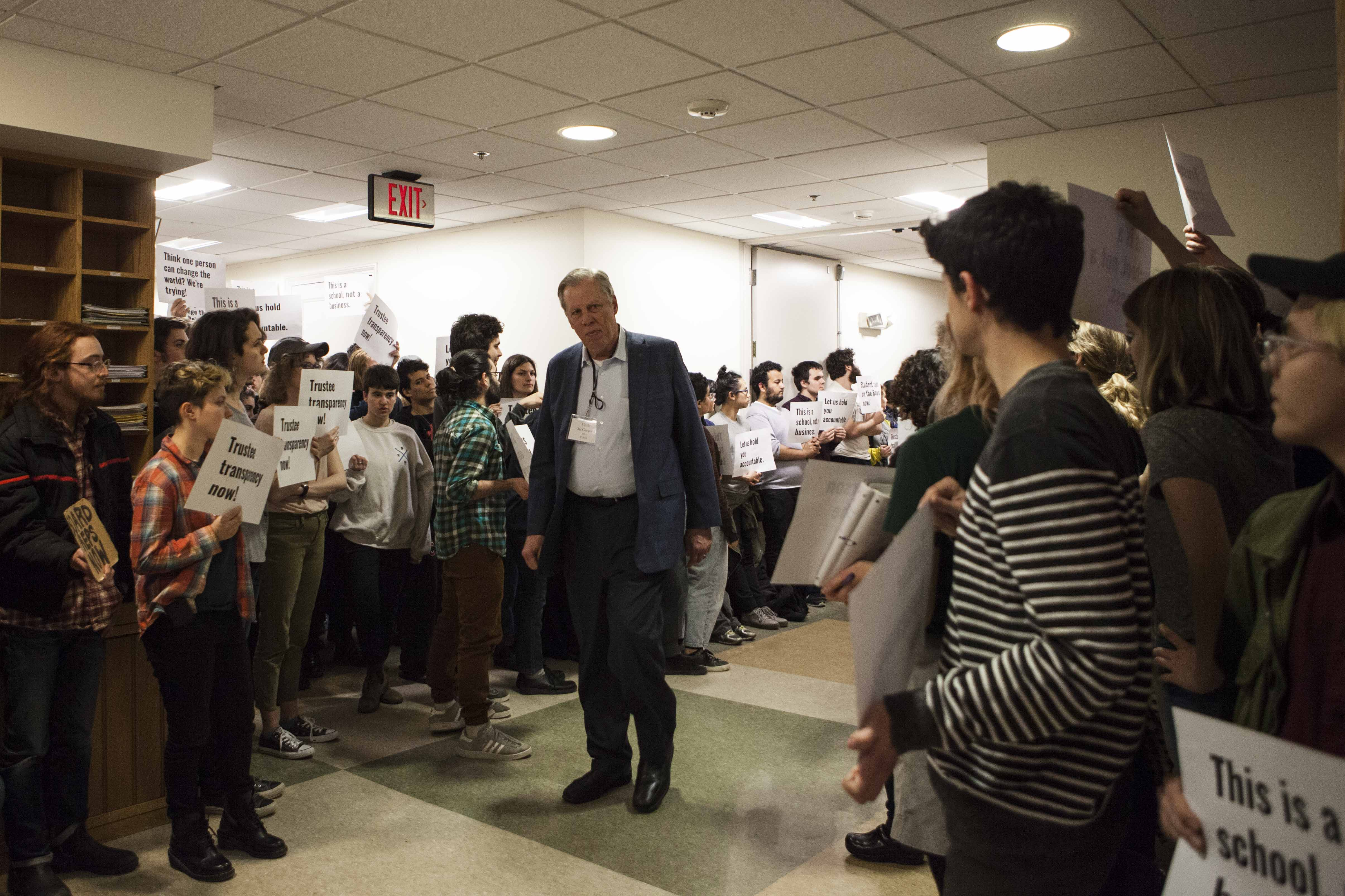 Student protestors surround Board of Trustees Chair Clyde McGregor as he makes his way to last night's board retreat. Students expressed frustration that the trustees have not involved students in their sessions.