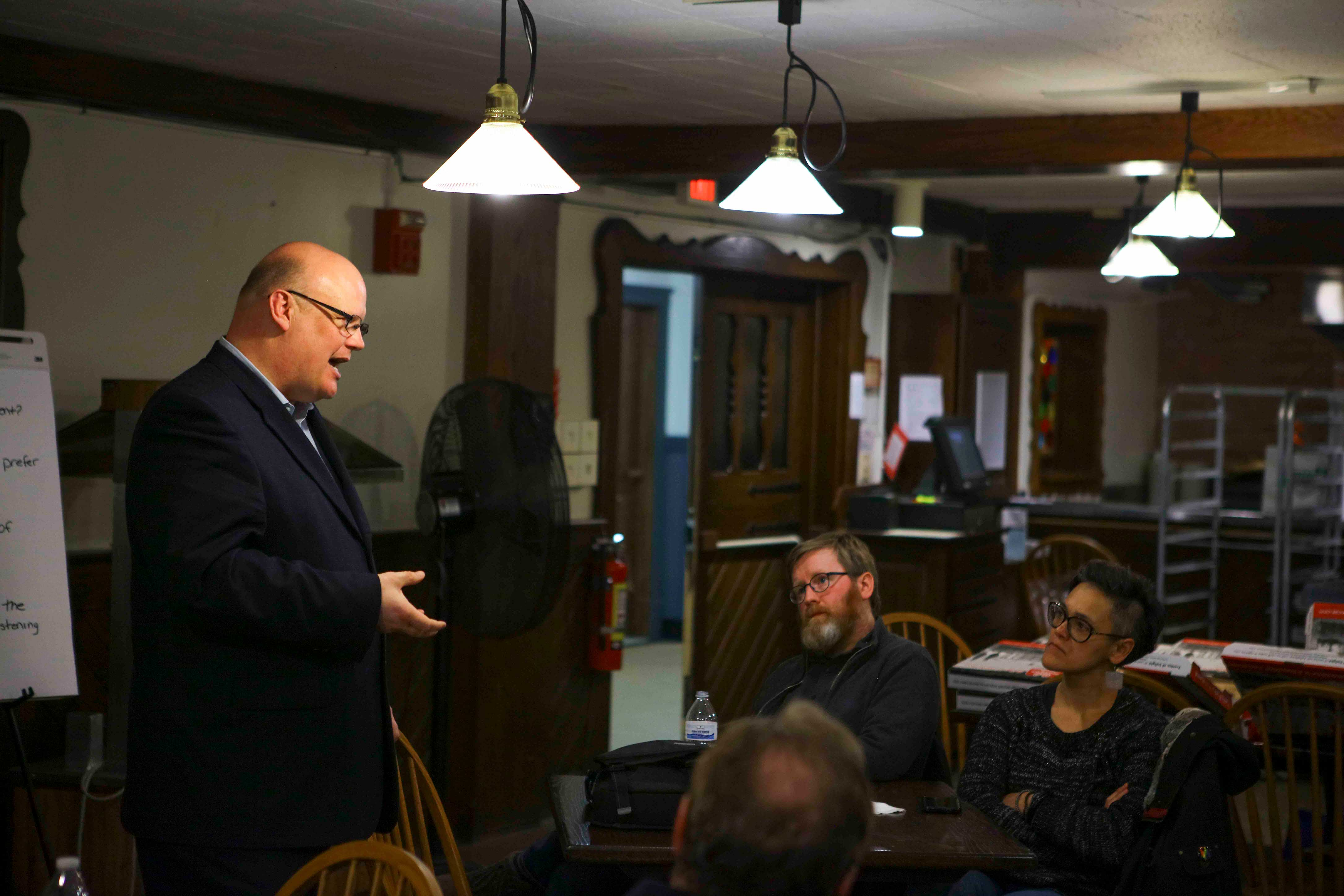 City Manager Rob Hillard holds a listening session with community members and students at the Rathskeller Monday evening as the search for the new police chief continues. The attendees emphasized that the new chief should prioritize residents' well-being.