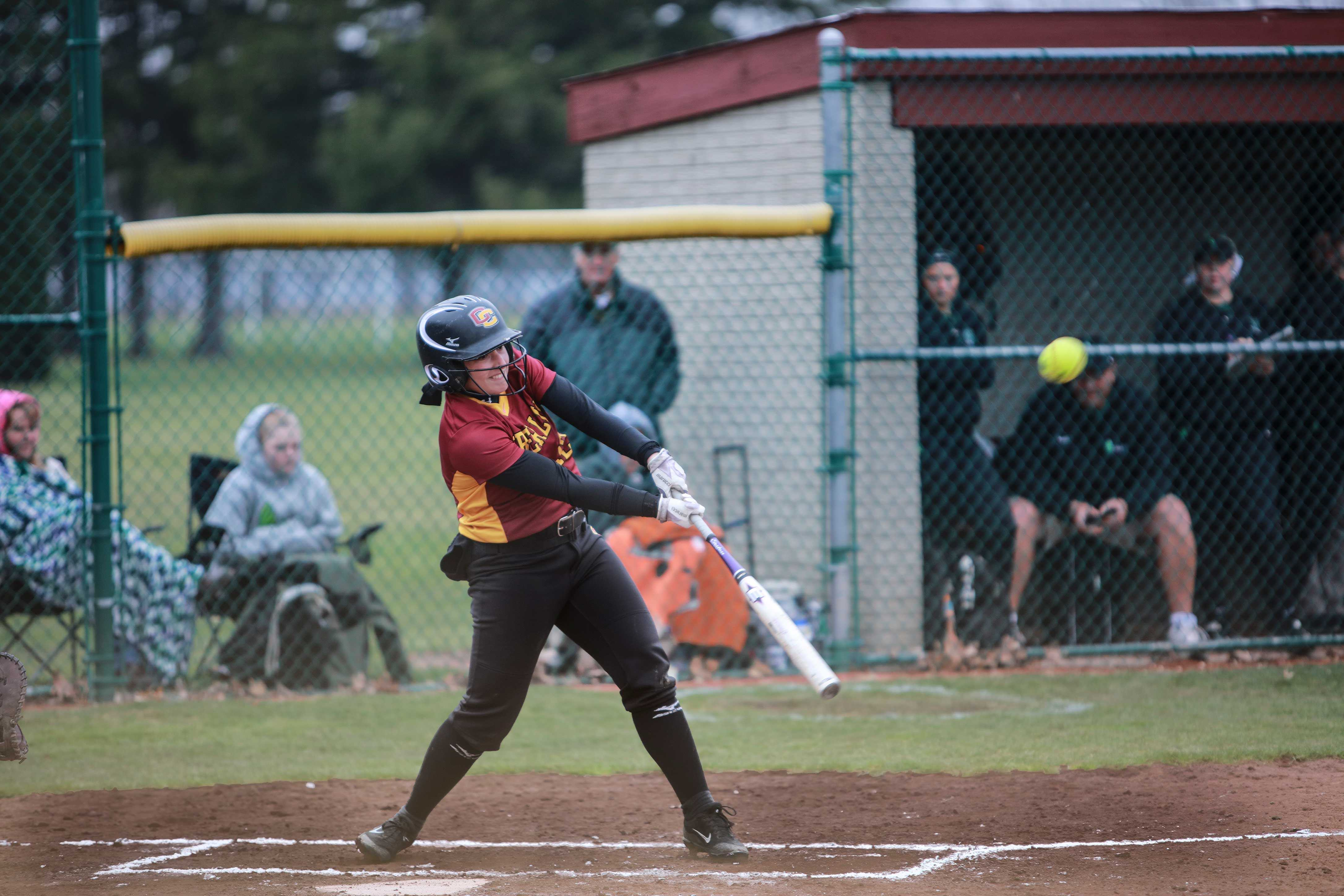Junior Dana Goldstein hits an incoming pitch in the Yeowomen's home opener against the Wilmington College Fighting Quakers. Oberlin split the doubleheader against Wilmington, winning game one 6–2 before falling 6–5 in the second.
