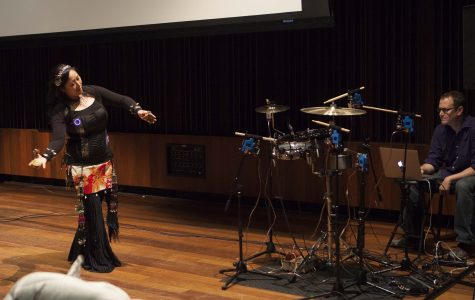 Assistant Professor Aurie Hsu performs a piece to electric drums Thursday evening in Clonick Hall as part of a weekend celebration of John Talbert's career.