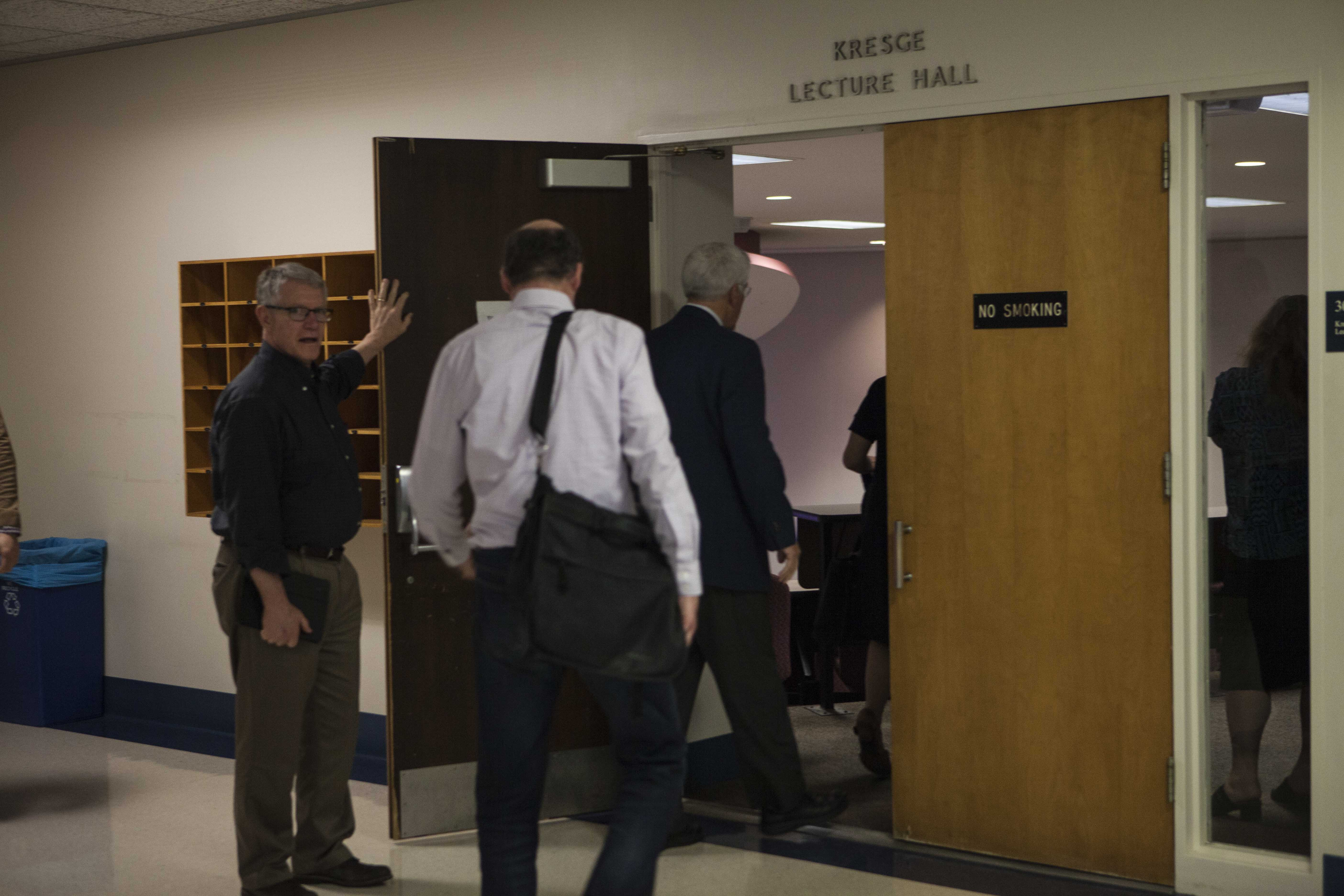 Faculty and administrators enter King Building Room 306 for Wednesday's General Faculty meeting. With impending administrative turnover, faculty is reckoning with the viability of the Strategic Plan.