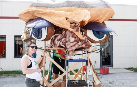 College senior and Big Parade Chair Chelsea Ettlinger poses next to a float being built in preparation for this year's Big Parade, which will begin at Prospect Elementary School tomorrow at 11 a.m. and make its way to Tappan Square. The annual event, which began in 2002, is free and open to all and features student-created floats, stilt walkers, bikes and other street performers. From noon to 2 p.m., the event will feature live music, face painting, free food and a pie-eating contest in Tappan Square. In the weeks prior to the parade, College students and community members attended open hours at the Big Parade's construction space behind the Student Health Center to construct floats that will run in the parade.