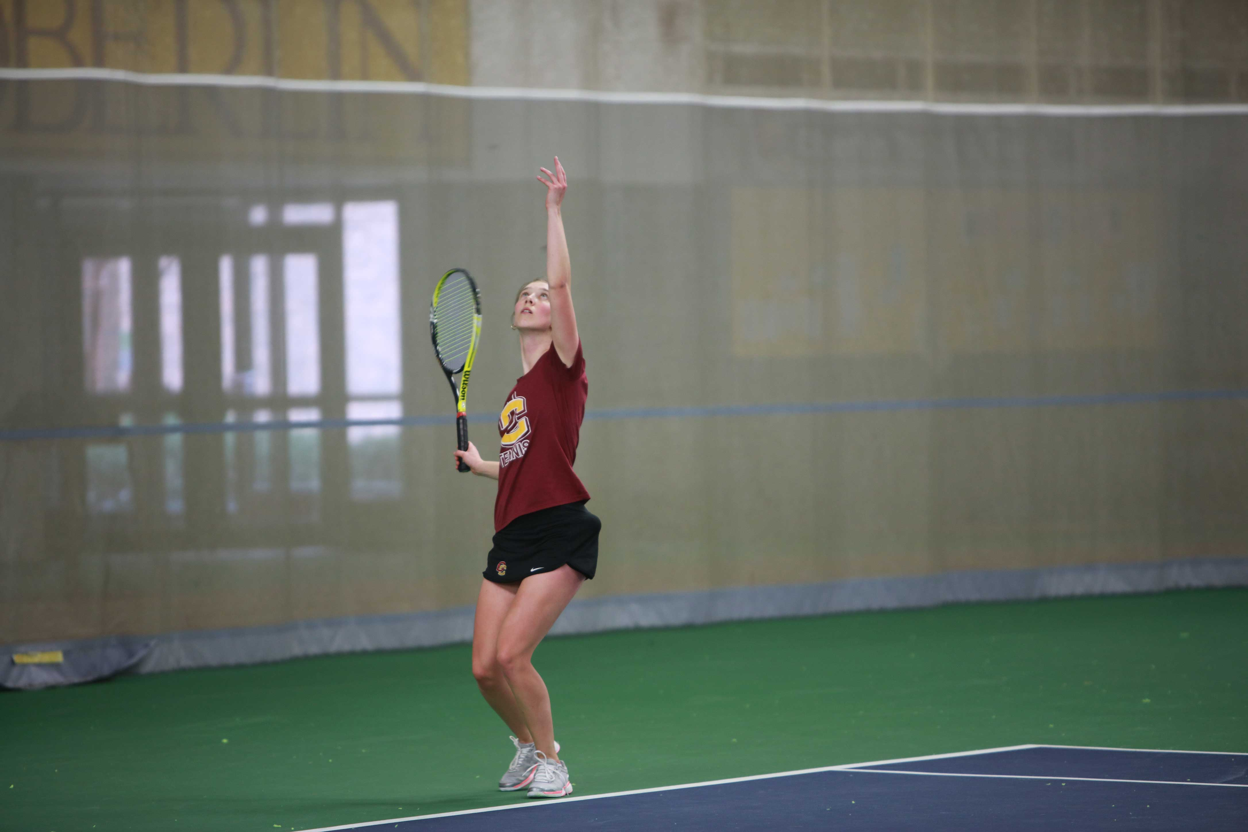 Senior captain Olivia Hay strikes trophy pose in the squad's match against University of Rochester on April 1. The Yeowomen will travel to Gambier, Ohio, to take on conference rival Kenyon College tomorrow.