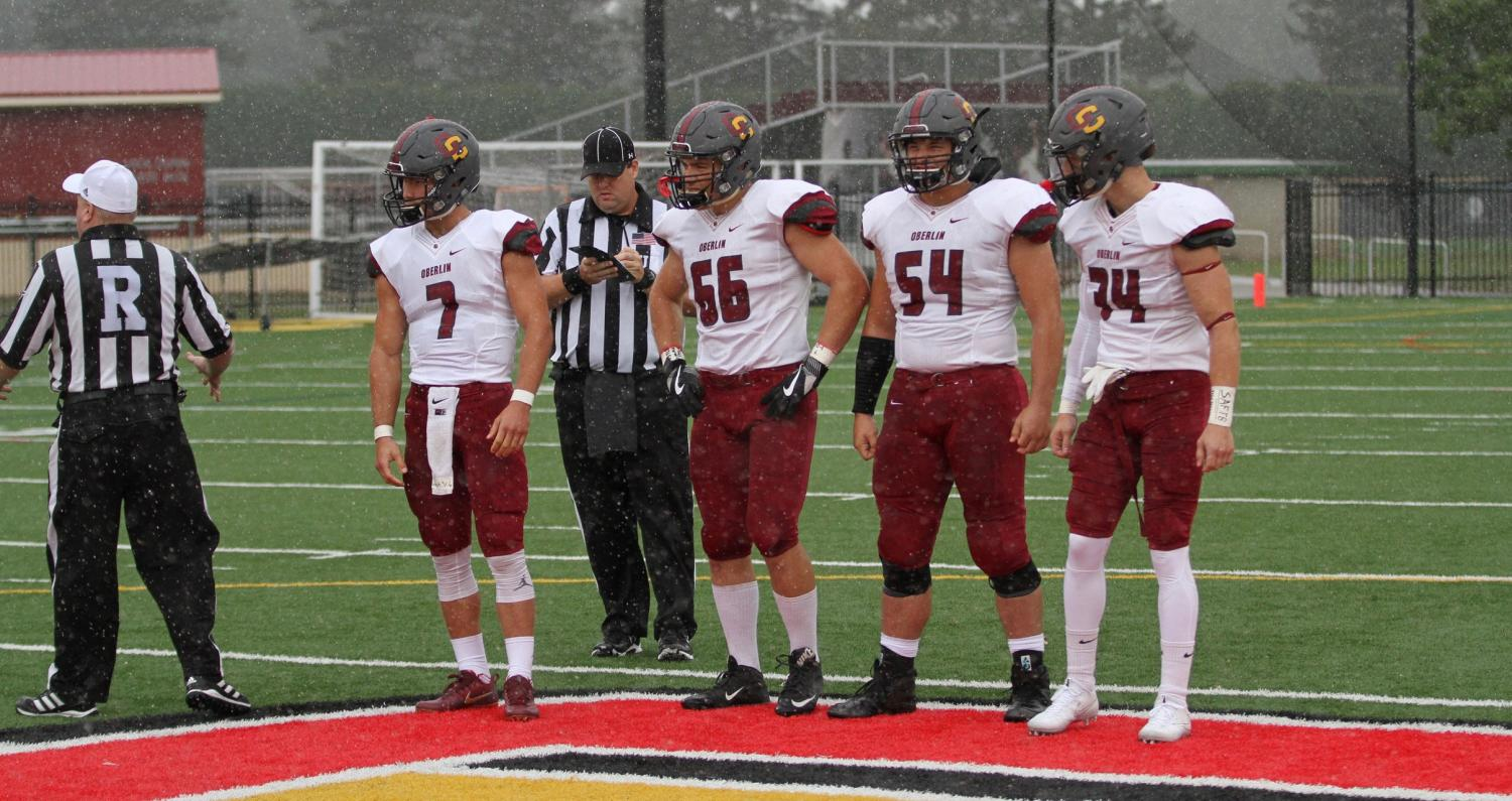 Senior captains Anthony Allen, number 66, and Avery McThompson, number 54, represent the Yeomen for the coin toss in their 24–6 season opening-victory against Kalamazoo College Sept. 2. The Yeomen will play the Denison University Big Red tomorrow in Granville, Ohio.