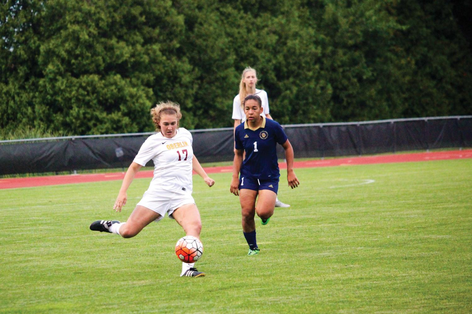Senior defender Lauren Koval rifles the ball past the University of Pittsburgh at Bradford Panthers' defense in their 4–0 win Sept. 1. The Yeowomen, who are 6–0–1, start conference play against Ohio Wesleyan University tomorrow at 3 p.m. at Fred Shults Field.