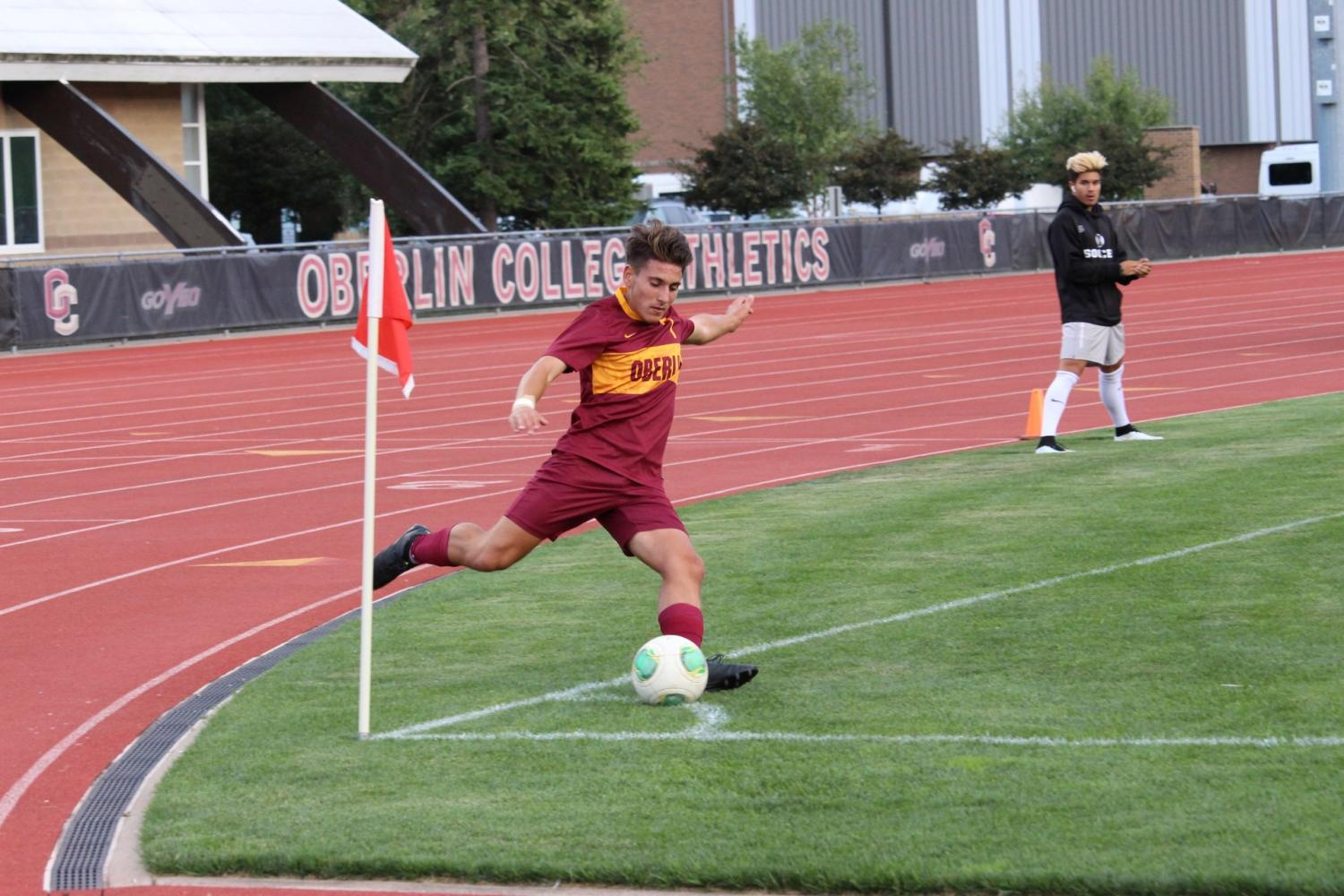 Junior midfielder Trenton Bulucea winds up for a corner kick during the Yeomen's scrimmage against the Capital University Crusaders. The Yeomen will begin their season today against Anderson University in Anderson, IN.