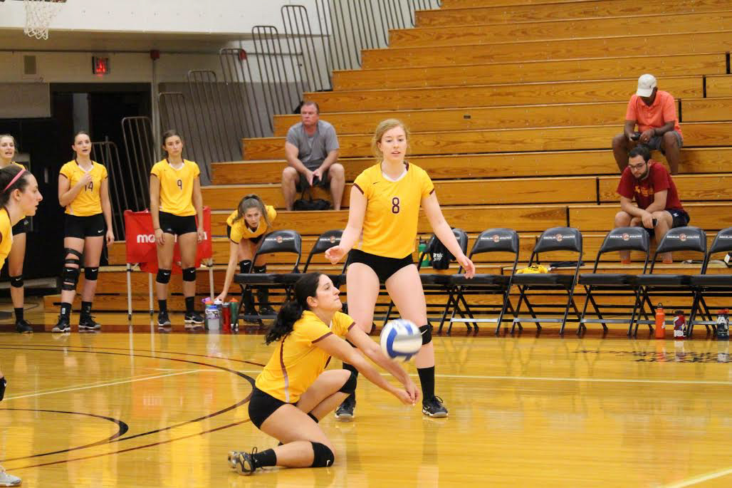 Senior captain and defensive specialist Lola Gatti passes the ball as junior outside hitter Julia Ingoglia offers support in a scrimmage against Lorain County Community College.