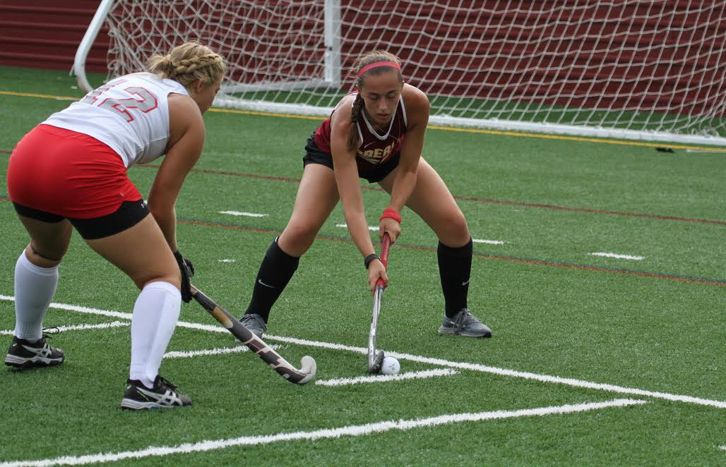 Junior+midfielder+player+Meg+Parker+carries+the+ball+past+the+opposing+offense+in+last+year%E2%80%99s+Oct.+22+matchup+against+the+Ohio+Wesleyan+University+Big+Red.+The+field+hockey+team+has+its+first+home+game+today+at+5+p.m.+on+Bailey+Field.