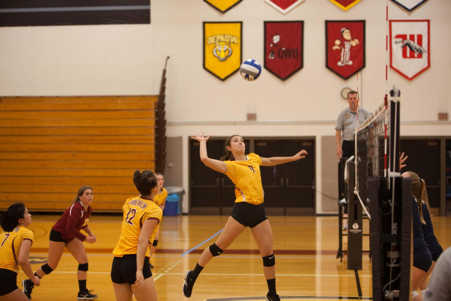 Sophomore middle hitter Jaya Flynn-Young spikes over the net as junior setter Sara Chang supports in the Yeowomen's victory over John Carroll University Wednesday.