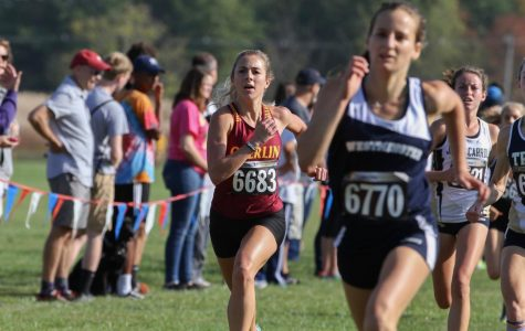 Senior Sarah Urso races alongside competition at the Oct. 14 Rumble. The Yeomen and Yeowomen are preparing to host the NCAC Conference Championship meet tomorrow at 11 a.m.