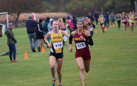 Sophomore Shannon Wargo races past Allegheny competition at last Saturday's NCAC championship meet on Oberlin's North Fields. Wargo finished in 10th place, with the fourth-best time for the Yeowomen.
