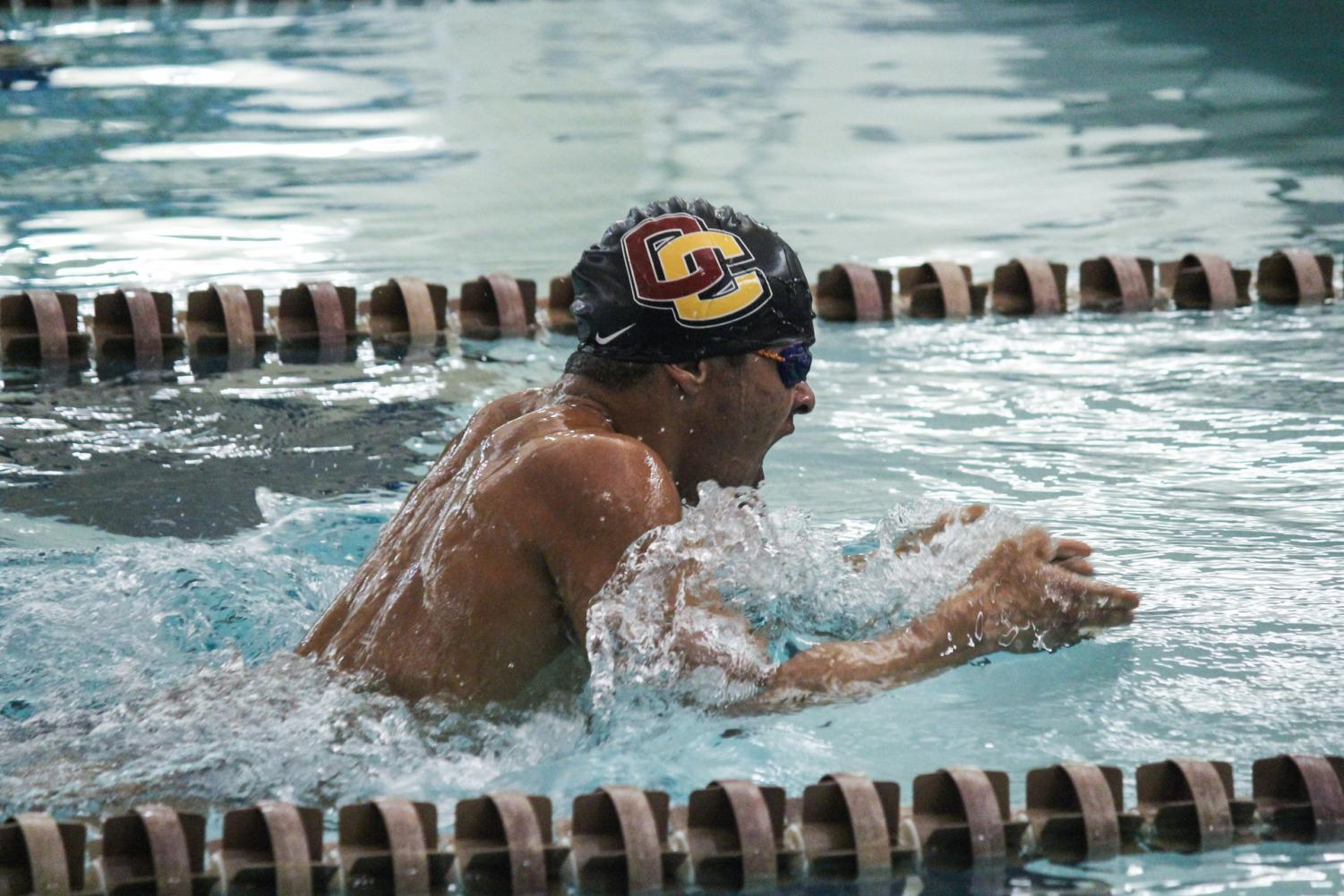 Junior swimmer Jacques Forbes competes at Oberlin's meet against the Hiram College Terriers last year. Both the men's and women's teams lost their meets against the Case Western Reserve University Spartans last weekend.