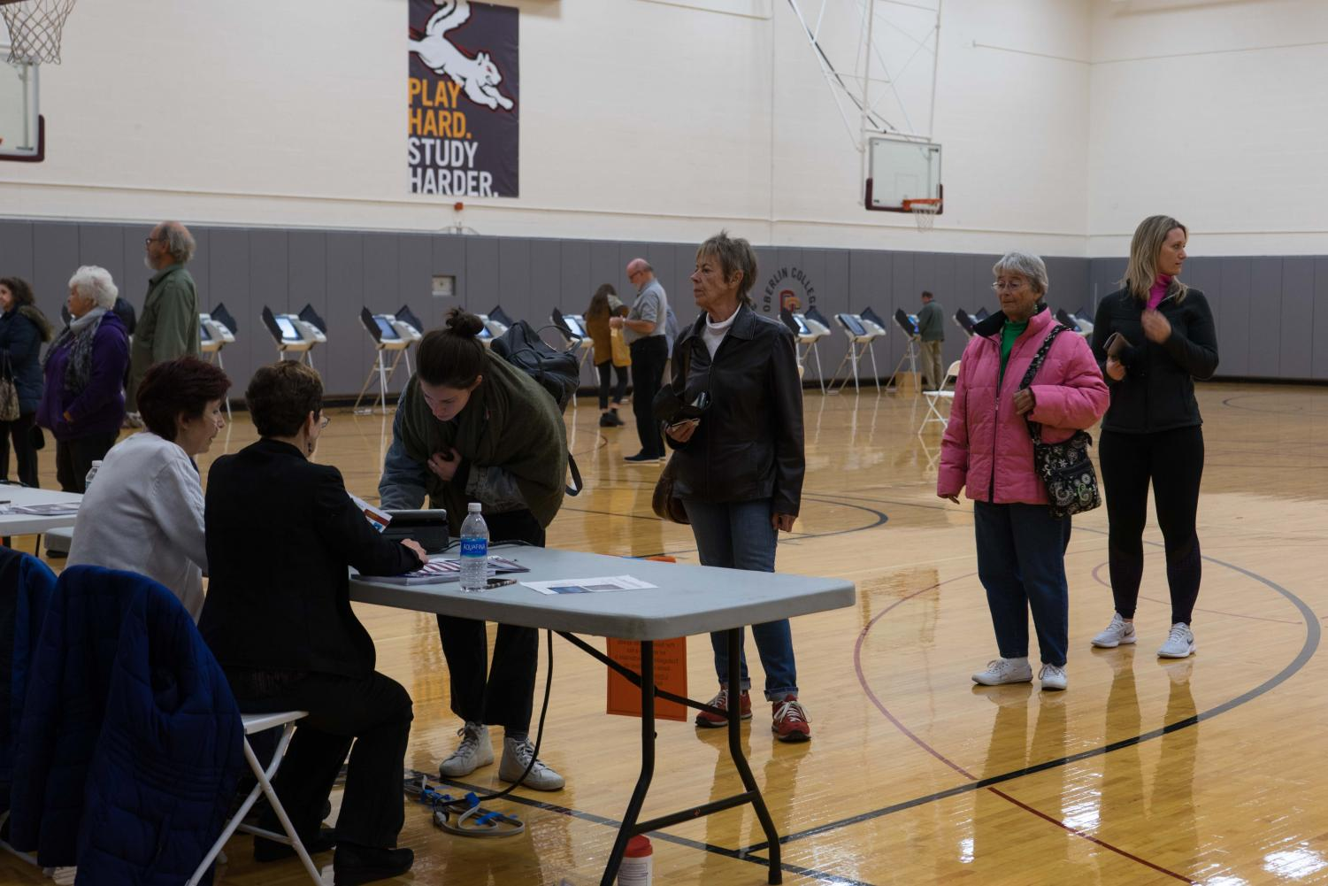 Oberlin students and residents vote in Tuesday's election in the auxiliary gym at Philips gym.