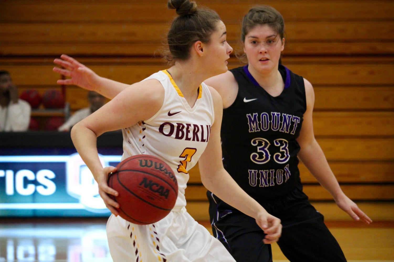 Sophomore guard Ally Driscoll tries to move the ball past a defender in last season's Nov. 28 loss to the University of Mount Union Purple Raiders. Wednesday, she scored a team-high 14 points in their 44–65 season opening loss to the Purple Raiders.