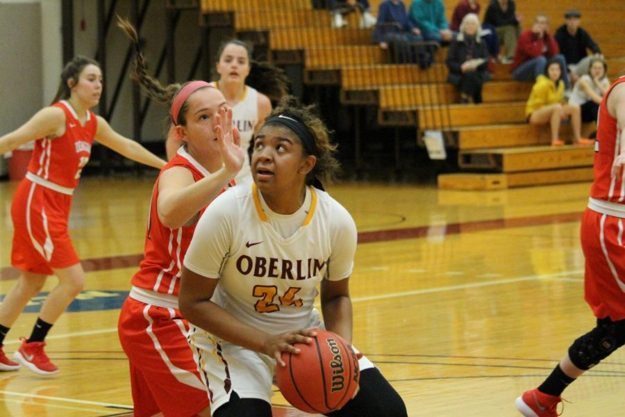 Senior guard Tyler Parlor rises up against a Denison University Big Red defender in the Yeowomen's 62–56 win Wednesday. Parlor netted seven points in the Yeowomen's third straight conference win.