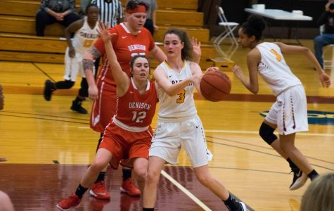 Sophomore Ally Driscoll looks to make a pass in a 66–52 victory Tuesday against #6 Denison University. The Yeowomen will face #2 Kenyon College in a semifinal matchup today at 7 p.m. in Greencastle, IN.