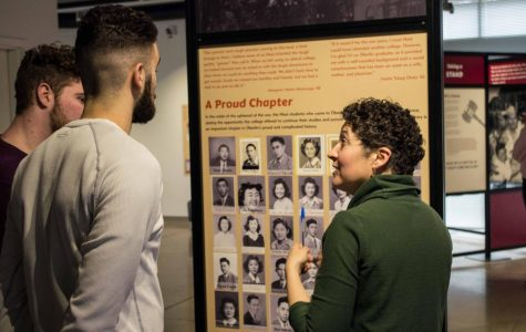 "Professor Renee Romano discusses the nationally-touring exhibit ""Courage and Compassion"" with sophomores Justin Godfrey and Abe Kuhn."