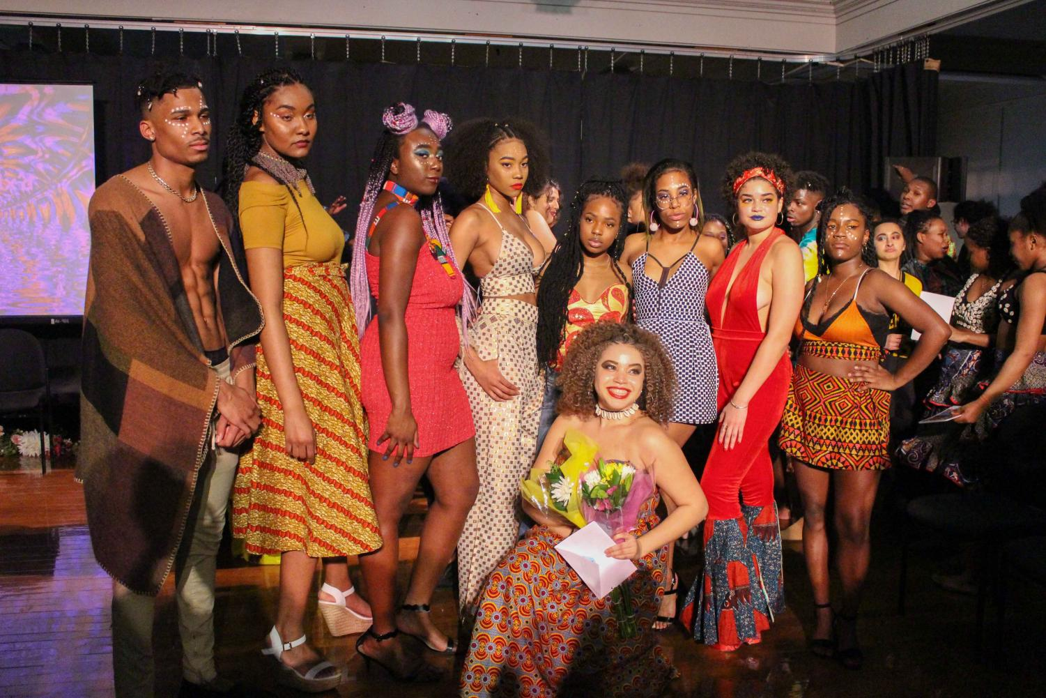 "Creative director, producer, and College senior Kiela Nelson, designer Imani Kutti, and models pose at ""Sankofa Remix'd: Reclaiming My Fly,"" the Black History Month Fashion Show."