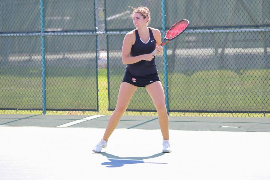 Sophomore Lena Rich prepares to return a serve at the Intercollegiate Tennis Association Central Regionals in September. Rich and her doubles partner, senior Mayada Audeh, had a decisive 8–4 win Saturday against Kalamazoo College.