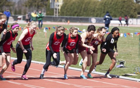 College sophomores Marija Crook and Shannon Wargo compete in the 1,500-meter at the Bob Kahn Invitational Saturday. Crook won the race, crossing the line in 4:53.31. Wargo finished in 4:58.45. Both the men's and women's teams placed first at the meet.