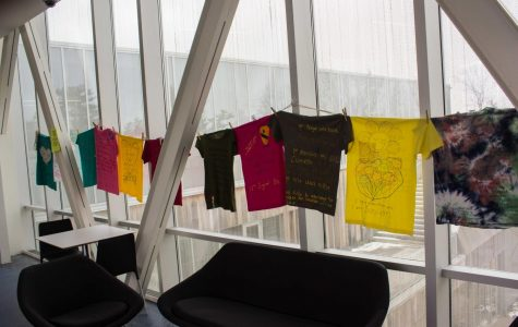 "Part of Consent Month at Oberlin, the Clothesline Project is a form of activism through visual art, addressing topics of sexual and gender-based violence. Visual art and graphic messages on t-shirts showcase stories and messages of solidarity while providing a voice for assault survivors. With the motto ""Break the Silence of Violence,"" the Clothesline Project is a worldwide initiative. Art is uncensored, intended to begin the healing process for survivors and memorialize victims of sexual violence. Presented by the Nord Center, the exhibit is on display in the Science Center and McGregor Skybar until the end of April."