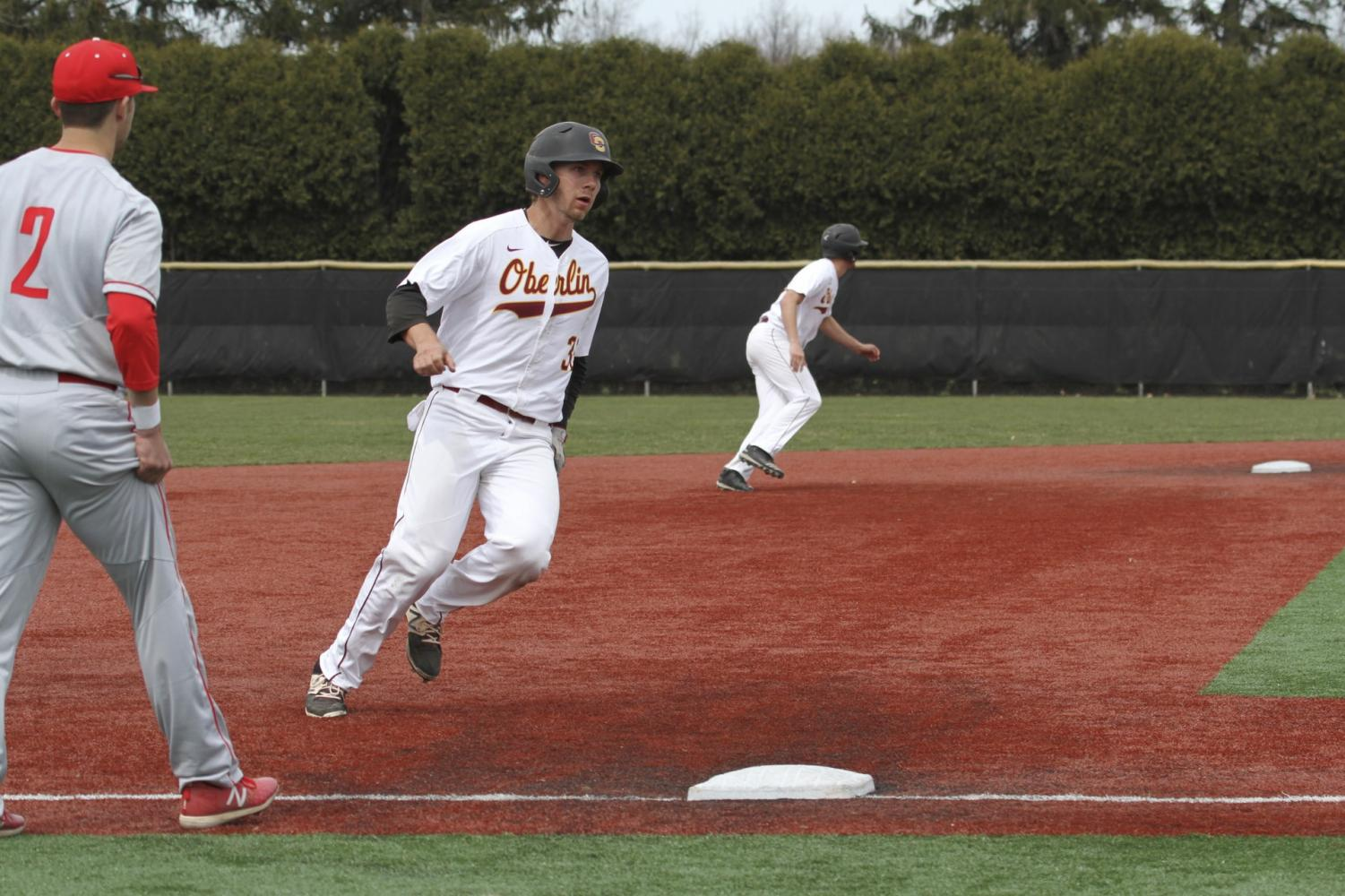 Junior third baseman Ian Dinsmore races around third base in an April 21 doubleheader against Wabash College. Although the team will not make its goal of earning a spot in the NCAC tournament, Dinsmore and his teammates look to end the season on a high note this weekend with doubleheaders against Hiram College and Cleary University.