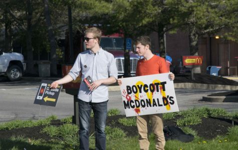College junior Haven King-Nobles and College sophomore Leo Hochberg protest outside Oberlin's McDonalds as part of a nationwide movement against the chain.