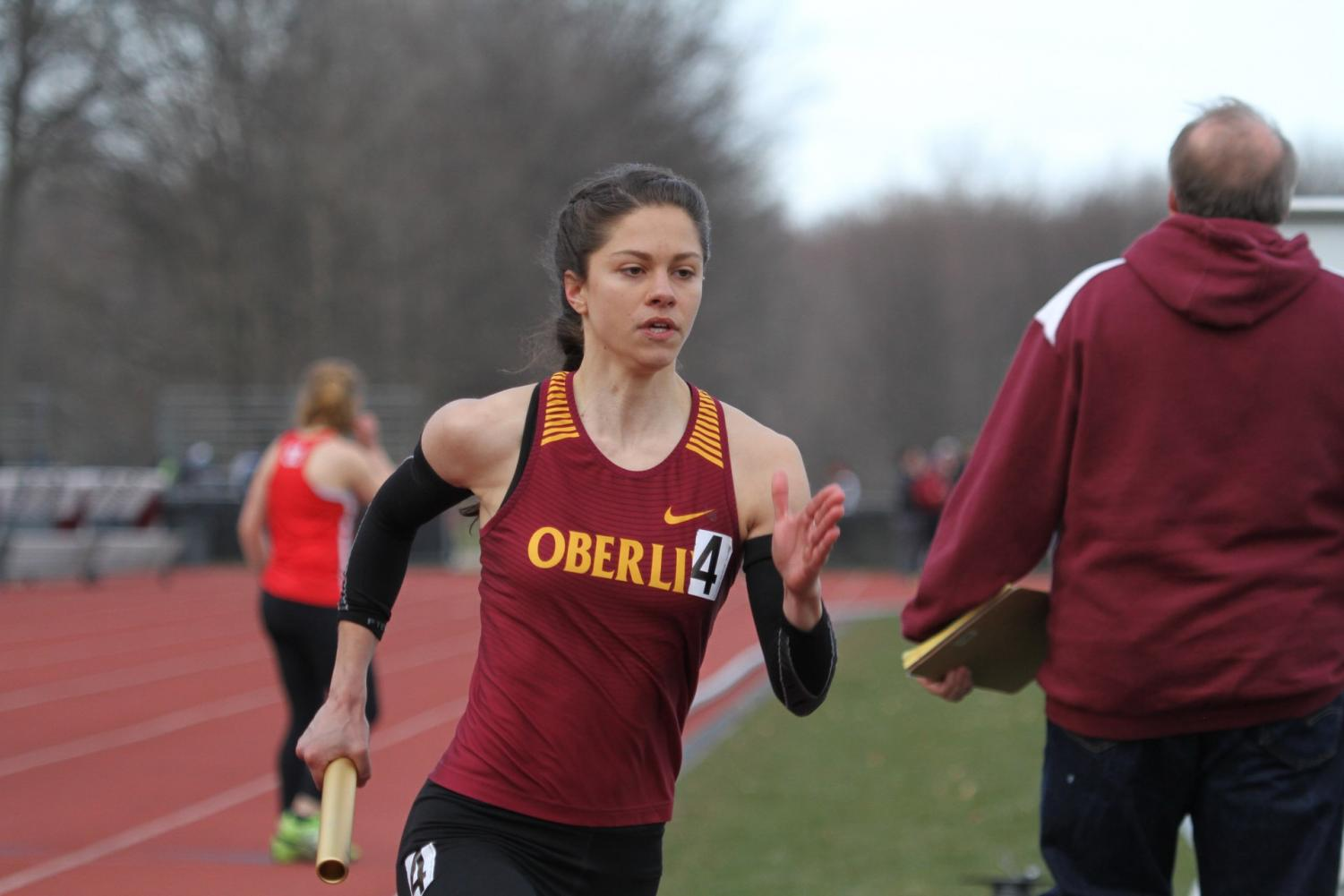 Senior Lilah Drafts-Johnson turns the corner in the Bob Kahn Invitational April 7. The women's track and field team won their second consecutive NCAC Outdoor Championship Saturday.