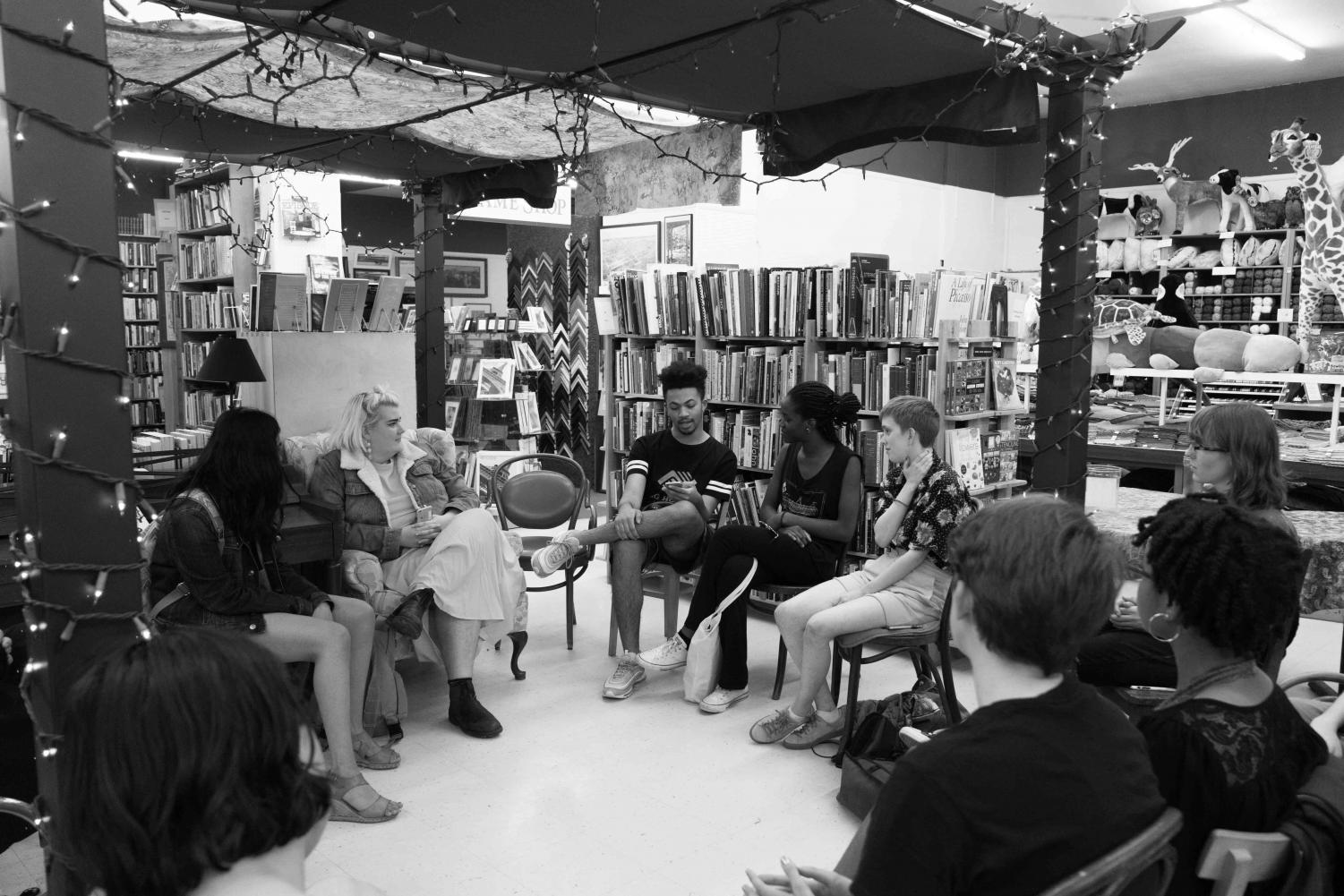 OSlam team members connect the College and town through poetry in the cozy, intimate mid-store gazebo in Ben Franklin Monday. The setting allowed performers and audience members to sit side-by-side in a circle. The poetry reading celebrated the end of National Poetry Month, and also featured some poetry from non-OSlam members.