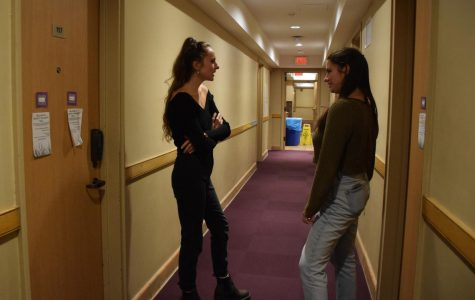 College sophomores Madeleine Faubert (left) and Jessie Julian (right) converse in Disability Solidarity Hall.