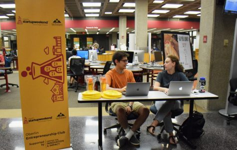 College sophomore Eduardo Sienra Lempeke (left) and College senior Jessica Moskowitz table for Oberlin's Entrepreneurship Club and Center for Innovation and Impact's first Startup Weekend, a 54-hour competition beginning Friday.