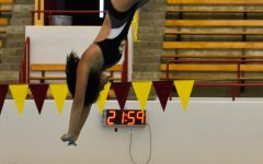 Sophomore Laura Young dives into the new pool.