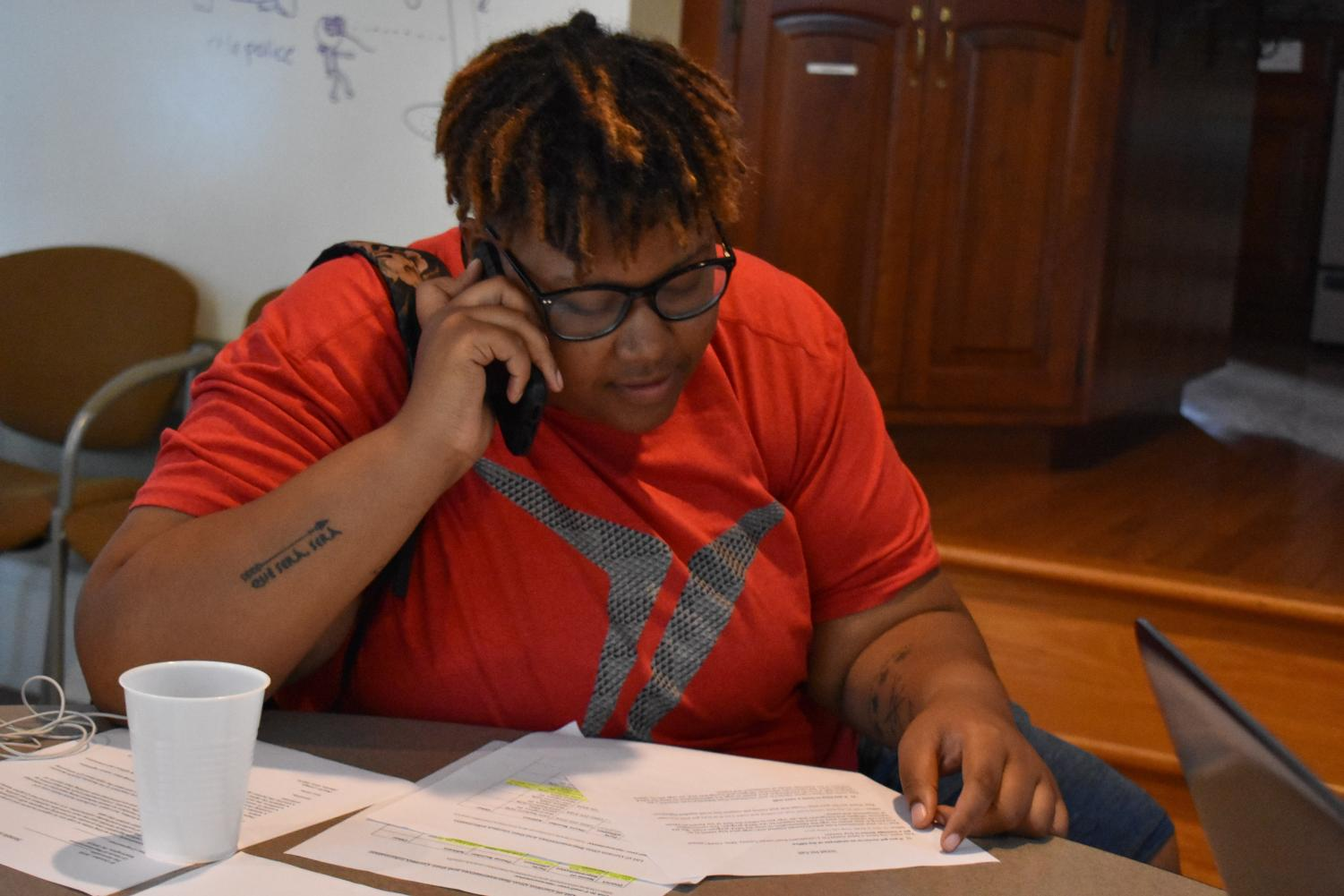 College senior Le'Priya White participates in Call Your Rep Day, an UndocuWeek event meant to encourage local representatives to adopt policies supportive of undocumented immigrants.