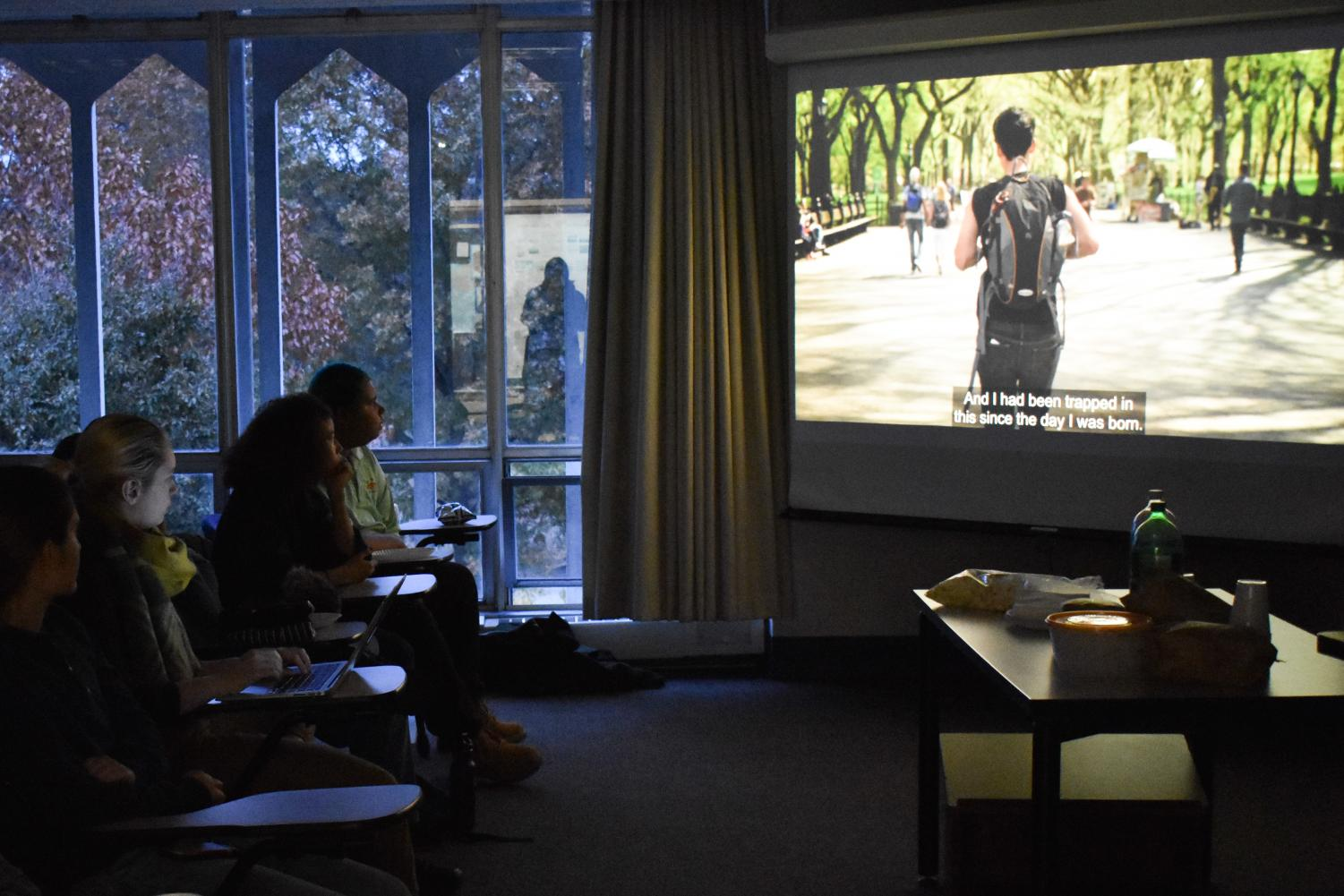 Students watch a screening of the documentary, We Exist: Beyond the Binary, as part of Trans Week of Action.