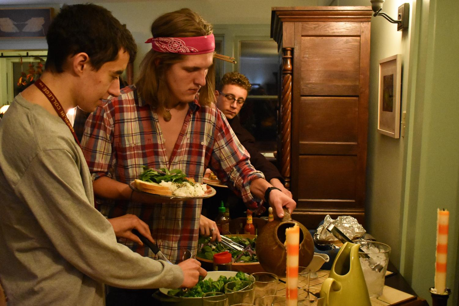 Students serve themselves at a dialogue dinner hosted at David Dorsey's home as part of the Barefoot Dialogue program.
