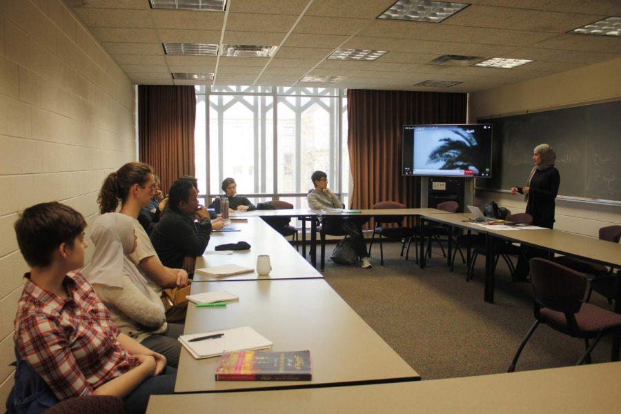 Students learn Arabic with teaching assistant Hawraa Sana.