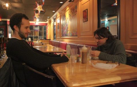 College senior Gabe Schneier and Conservatory junior Emmett Sher eat a meal at Catrina's, Oberlin's newest restaurant.