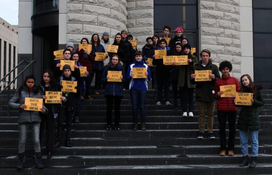 Student members of Oberlin's new chapter of the Sunrise Movement gather at Senator Sherrod Brown's office to demand he support the Green New Deal.