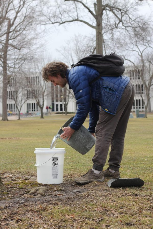 Will+Wickham+prepares+materials+for+tapping+trees+in+Tappan+Square.+The+sap+they+collect+will+be+boiled+into+maple+syrup.+