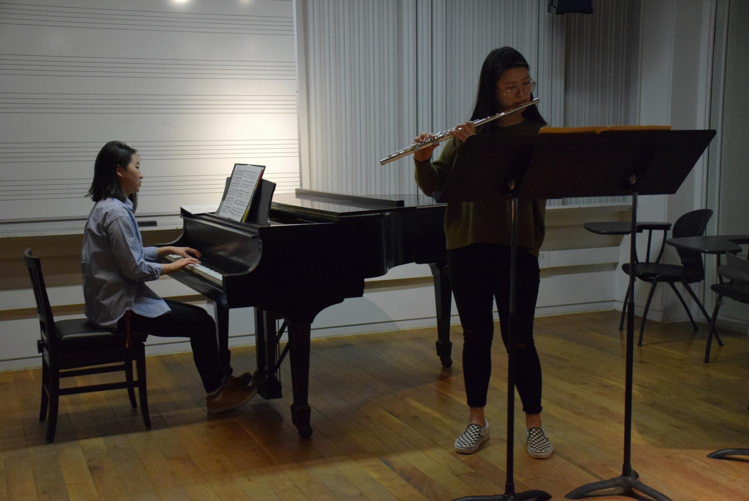 Conservatory sophomore Josephine Lee and double-degree junior Phoebe Pan practice together in Bibbins Hall.