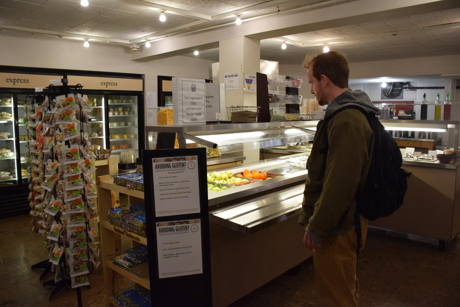College senior Noah Binford checks out DeCafé's lunchtime offerings.